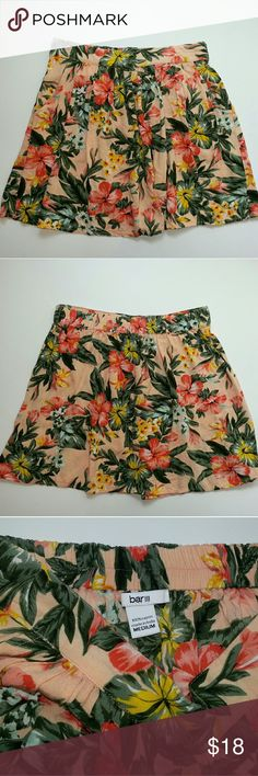 """Bar III Tropical Floral Mini Skirt with Pockets Excellent gently loved condition. No holes, stains, tears or signs of wear. Orange sherbet colored background with green foliage and orange, blue and yellow flowers. Measurements laying flat Waist 13.5""""  Length 15""""  Feel free to ask any questions, request additional measurements or additional photos.  Please submit offers through the offer button. My bundle discount is 15% off 2+!!  New items added weekly Urban Outfitters Skirts Mini"""