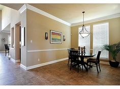 I like the white molding with tan wall color.