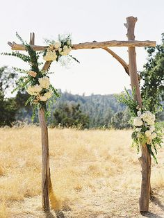 """Driftwood Arch: Showcase your perfect place to say """"I do"""" with a beautiful arch decorated with greenery and florals. This unique arch will do nothing but add to your outdoor wedding ceremony décor and leave your guests in awe. 