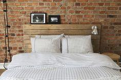 Brick wall and pallet headboard.