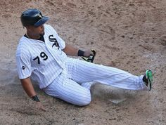 ea0f14724 Jose Abreu Photos Photos - Jose Abreu  79 of the Chicago White Sox slides  across
