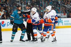San Jose Sharks forward Andrew Desjardins exchanges words with several members of the New York Islanders (Nov. 1, 2014).
