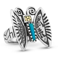 Aflutter with ancient symbolism and modern style, this Roderick Tenorio butterfly ring  is made from a beautiful blue trapezoidal turquoise cabochon, and represents the soul of the of universe. The sterling silver wings    are engraved with designs of sacred corn stalks and the Southwestern deity, Kokopelli, playing his magical flute. The face of the butterfly is crafted from 14K gold and sterling silver. Decorating the rings shank and the backside of the butterfly are sunflower accents.