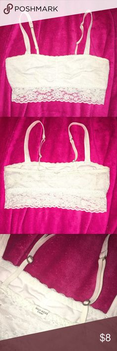 """Gully Hicks Unlined Bralette ‼️BUNDLE & SAVE‼️*add to dressing room bundle & expect a private offer! Super Cute Gilly Hicks Unlined Bandeau -Size S *Stretchy* -Straps are adjustable but not removable -NEVER WORN, PERFECT CONDITION -Color is White -Front is Opaque, Back is Sheer Lace 🚬Smoke free environment 💸Price is negotiable, MAKE AN OFFER! 👇➖➖➖➖➖➖➖➖➖➖➖➖👇 •Additional pictures upon request •Pls ask ALL questions prior to purchasing •Offers via """"offer"""" button only •No trades, no holds…"""