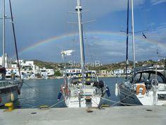 Full rainbow over Sailboat in Greek Island