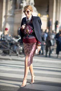 Maximalism at its finest: Great example of layering during transitional weather by Sarah Rutson in an embroidered sweater, floral print silk pencil skirt, metallic stilettos & w/ lots of jewelry #StreetStyle