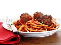 Ricotta-Filled Meatballs with Fennel and Chili : Red pepper flakes give Food Network Magazine's meatballs serious heat. A stuffing of fresh ricotta balances every bite.