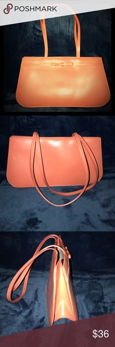 Talbots Leather Purse NWOT A beautiful solid peachy orange color  Talbots leather purse has three pockets inside one with a zipper and it has a magnetic button closure in the middle the purse measures 13 inches from left to right 7 inches from top to bottom and is 4 inches wide when open fully!! The straps are 10 inches in length&can be worn on the shoulder or just on the arm in excellent condition from a smoke and pet free house Talbots Bags