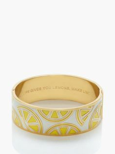 "Kate Spade idion bangle | Inscription reads ''when life gives you lemons, make limoncello""."