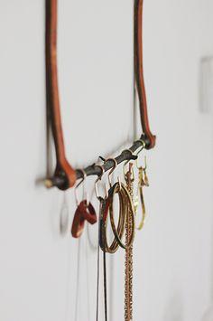 Repurposed belt & twig jewelry organizer.