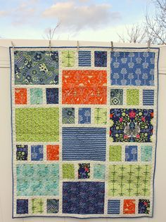 A simple and quick quilt made from 9 fat quarters plus solid sashing, subcut fat quarters into 1 big rectangle and 3 smaller rectangles, from: Diary of a Quilter - a quilt blog: Safari Moon - new Art Gallery Fabrics quilt