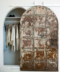 textured interior barn door via Atticmag