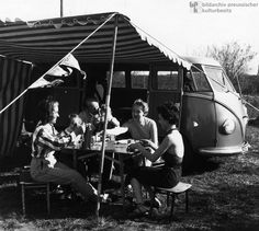 Camping with a VW-Bus in Germany (1952)  In the 1950s, West German society became increasingly motorized: the number of passenger cars in use rose sharply from 515,608 in 1950 to 4,066,000 in 1960. The growing popularity of camping was a direct result. Between the early 1950s and 1957, the number of campsites in the Federal Republic tripled from 200 to 600. Between 1958 and 1961, overnight stays at campsites also increased threefold. The photograph shows a Bavarian family in front of the…