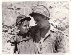 U.S. soldier befriends a little girl in Sicily. 1943.
