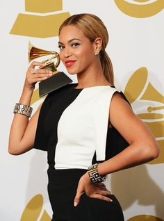 Beyoncé struck a pose with her Grammy after the show! #GRAMMYs #Beyonce