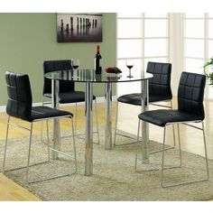 Update the look of your dining area with this five-piece counter-high dining set. The contemporary set includes a round glass-top table and four chrome-plated chairs upholstered with black leatherette, which gives the set a modern look.