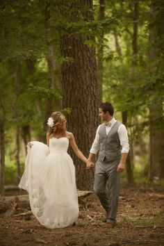 Grey pants and vest for the groom and I kinda love the flower in the brides hair
