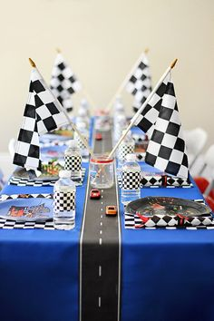 Racers, Start Your Engines! Now you can purchase the signage from one of Pinterests most popular race car birthday parties! Make your dessert or cake table stand out with this cake table backdrop featuring checkered flags, a red, yellow, and blue bunting, and traffic lights! This PDF