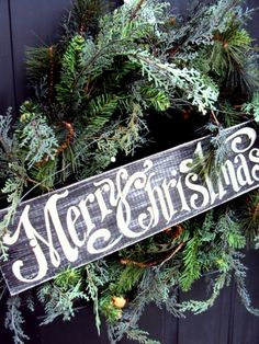 """Vintage"" Merry Christmas sign on natural front door wreath. (Link does not work but image is enough to DIY) LOVE!!"
