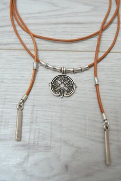 Item details: Its a wrap choker made from genuine leather cord with a unique antique silver coin inspired by ancient Greek and Byzantine art, silver plated tube spacers, end caps and bars charms. This leather choker is made to wrap around your neck twice. It can be worn in many