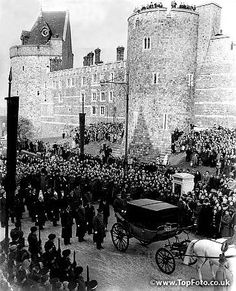 Dukes walk behind the carriage conveying the Queen, Queen Mother, Princess Margaret and Princess Royal, as the funeral procession of King George VI skirts the ancient walls of Windsor Castle.15th February 1952.