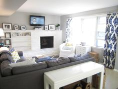 Sherwin Williams Mindful Gray paint color. Like the dark gray sectional with white tables and chair. Yellow/white pillows work nicely. Dark blue curtains?