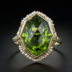 Colored wedding rings are in. Love this Octagon Peridot and Seed Pearl Ring 1930s | Lang Antiques