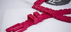 For Frequent Flyers: Inspired by the composition of a bike chain, this belt is designed by Freedom of Creation and comes in a selection of colors from Raspberry Red to Graphite Black. Made of Nylon fiber, the belt is 3D printed in one piece on an SLS (Selective Laser Sintering) machine, using Cubify Cloud Printing.