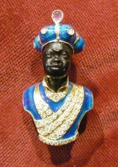Blackamoor brooche Enamelled ~  Yellow Gold 18 kt Diamond Ruby on turban head in carved ebony