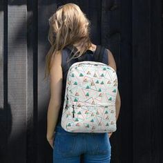 This medium Women's Triangle Backpack is perfect for daily use or sports activities! The pockets (including one for your laptop) give plenty of room for all your necessities, while the water-resistant material will protect them from the weather. Sports Activities, Are You The One, Fashion Backpack, Triangle, Backpacks, Laptop, Weather, Pockets, Medium
