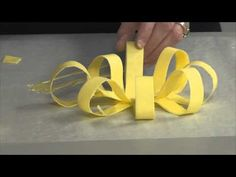 How to make a chocolate bow by ShopBakersNook.com. All you need are chocolate chips and parchment paper!