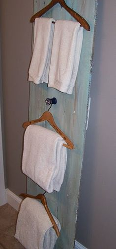 I like this idea, maybe with some vintage knobs. I could use it on the back of the bathroom door.