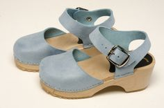 Sky Blue Mary Jane Clog - Mary Jane shoes have been a footwear figure for the last century. Why not in clogs?  Sky Blue-colored soft leather uppers with a complete ankle strap construction, these sophisticated clogs will be fun for your little girl's outfit!  Available in Children's sizes 24-34. Order here: http://store.capeclogs.com/childrens.aspx.