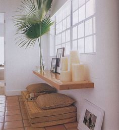What if we put a table in front of the window, and put candles on it, a plant nearby? Wish the baseboard heaters weren't right under the windows, we could stack pillows there. Dangit.