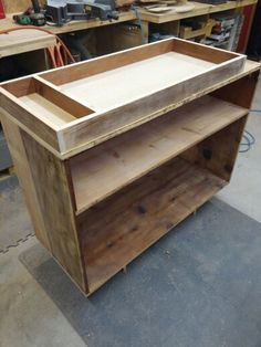 Baby changing table I made for my 2nd granddaughter. Made from an old book case