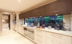 Kitchen 2 - dark timber veneer laminate contrast with the gloss white drawers is something different