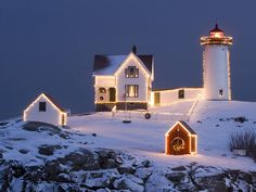 Cape Neddick Light, otherwise known as Nubble Light, the lighthouse I used to live near in Maine and lighthouse I have visited the most, bar none. Yes, it looks just like this in the winter and you cannot get to it; it is across the water on an island. - Lydia