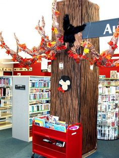 "Library Tree 2 - library support column covered with painted paper to create an autumn tree, great use of often ""useless"" architecture School Library Decor, School Library Displays, Library Decorations, Class Library, Future Library, Library Design, Library Inspiration, Library Ideas, Teaching Displays"