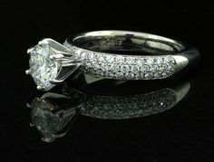 Custom handcrafted diamond engagement ring with pave style shank in 14k white gold and a 6 prong head