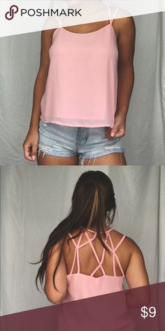 light pink tank top Light pink tank top with lots of straps in the back, perfect for summer! Tops Tank Tops