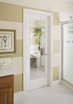 A mirror has been placed in the door single panel, which is perfect for a bath or master bedroom with limited wall space.