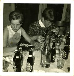 What a look! Found this little photo in an imported vintage Danish chest of drawers.. 1960's Danish fab teens enjoying a smorgasbord of beer. And that's not a big bottle of water either!