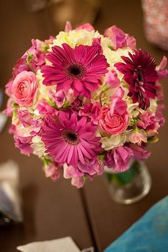 fuchsia gerber daisies, small pink roses, sweet peas and white hydrangea wedding bouquet