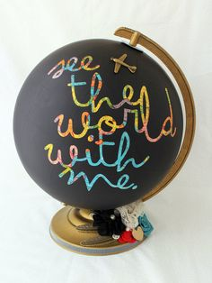 """A few coats of chalkboard paint instantly elevate this old globe from kitschy to artistic, and """"See the world with me"""" is a lovely little quote to inspire those daydreams. Get the tutorial at Maya Road Design Team."""