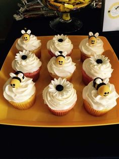 Cute cupcakes at a bumble bee themed baby shower party! See more party planning ideas at CatchMyParty.com!