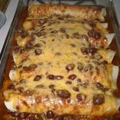 Chili Dog Casserole  --  beef wieners rolled up in flour tortillas, covered with canned chili, topped with shredded cheddar and baked.