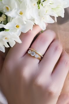 A Three-Stone Diamond Ring made out of Solid Gold. Choose a Yellow Gold, White Gold or a Rose Gold. Simulated Diamonds on top of the engagement ring. The matching band is covered with 19 gemston. Modern Engagement Rings, Three Stone Engagement Rings, Perfect Engagement Ring, Engagement Bands, Engagement Ring Settings, Diamond Engagement Rings, Three Stone Diamond Ring, Diamond Bands, Gold Bands