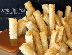 """The easiest apple pie recipe ever has been transformed into a fun, snack-like dessert. I Can't Believe It's Not Apple Pie Fries have all of the flavor of an apple pie but in finger food form. Each """"fry"""" is like a mini apple pie in itself. Fried Apple Pies, Fried Apples, Just Desserts, Delicious Desserts, Dessert Recipes, Puff Pastry Desserts, Apple Pie Recipes, Thanksgiving Desserts, Cooking Recipes"""