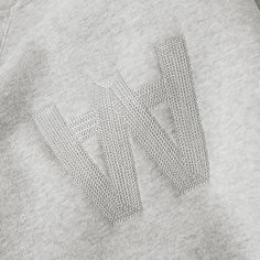 Always aiming to find the perfect balance between style and functionality, the Wood Wood collections have evolved into sophisticated streetwear, while keeping their playful graphics and signature branding. Taking on a sports-approach to contemporary streetwear, this Houston sweater is solely styled with the instantly recognisable AA embroidery placed at the chest.  88% Cotton, 8% Nylon, 4% Elastane  Embroidered AA Logo V Insert Neck Detail  Ribbed Collar, Cuffs & Hem
