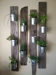 Vertical Gardens indoor herb garden idea: Tin Buckets on Re-Purposed Wood - In this post, we'll share 9 beautiful ways to bring your herb garden indoors, so that you can enjoy fresh herbs all year long. Vertical Garden Planters, Vertical Gardens, Planter Pots, Balcony Garden, Planter Ideas, Planter Garden, Wall Garden Indoor, Garden Walls, Small Gardens